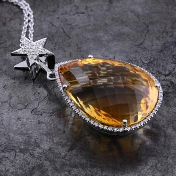 halo pendant with pear shaped faceted citrine with above which a star with pavé set  brilliant cut diamond and with the Tetyana aside in the baté