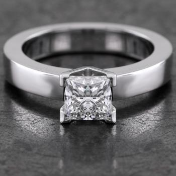 solitaire ring with a princess cut diamond set in a tight square and slighlty higher setting