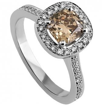 entourage or halo set ring with a central cushion cut diamond fancy orangey brown surrounded by on the band with slightly curved palmettes and pavé set with smaller brilliant (V mounted slightly higher for a close matching wedding band)