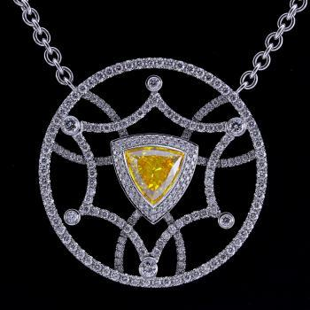 pendant with a central deep orangey yellow triangle surrounded by an ornament set with brilliant cut diamonds (including roloketting)