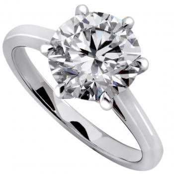 solitaire ring with a brilliant cut diamond on a thinner band with palmets