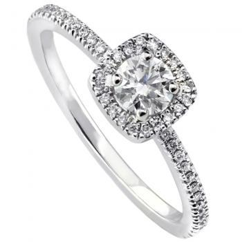 entourage ring with a central brilliant cut diamond with a cushion shaped entourage with castle set diamonds