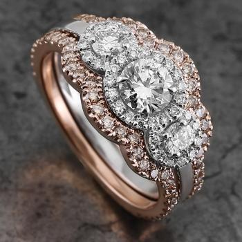entourage trilogy ring with three central diamonds surrounded with brilliant cut diamonds mounted between fixed step rings castle set with fancy dark brown diamonds
