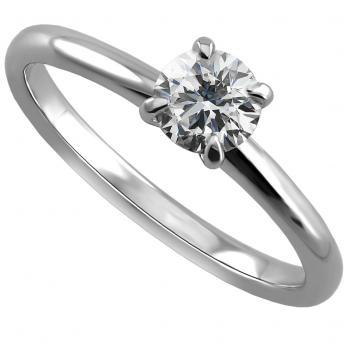 handmade solitaire ring with a brilliant cut diamond set in 4 prongs rounded setting made of round wire