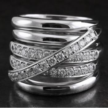 handmade ring with six rounded and massive crossing and flanking bands, three of which are pavé set with a row of brilliant cut diamonds