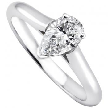 solitaire ring with a pear shaped diamond set in prongs between a band with palmettes