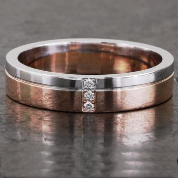 handmade slim wedding ring with an engraved line on a third and set with three diamonds set crosswise