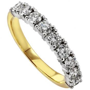 wedding ring set with brilliant cut diamonds with four prongs per diamond