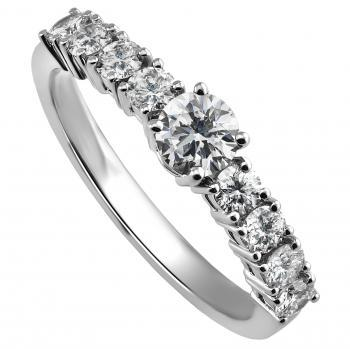 ring with a central brilliant cut diamond and two times smaller diamonds on the side all set with four prongs