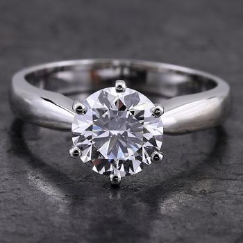 solitaire ring brilliant cut diamond in tiffany 6 claws on a narrowing band towards the setting
