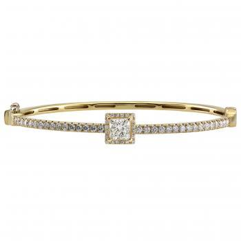 halo set esclave bracelet with a princess cut diamond surrounded and flanked by castle set brilliant cut diamonds