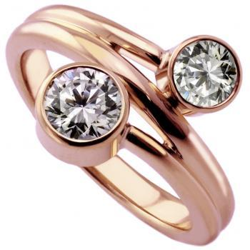 Toi et Moi ring with two brilliant cut diamonds bezel set in two pots