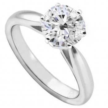 solitaire ring with a brilliant cut diamond set with four claws on a shank with palmets