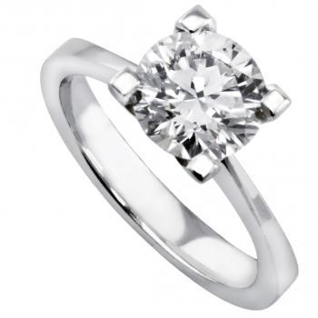 solitaire ring with a brilliant cut diamond set in four slimmer prongs on a smaller band