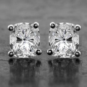 solitaire earrings with cushion cut diamonds  set in four rounded curved prongs or claws