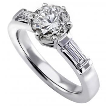 ring with a central brilliant cut diamond with two baguet shaped diamonds on the side