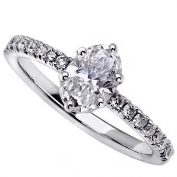 solitairering with oval cut diamond and pavé set brilliant cut diamonds on the side