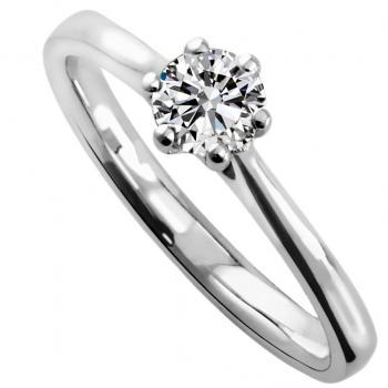 solitaire ring with a brilliant cut diamond in a lower and rounded setting