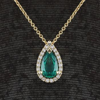 entourage or halo pendant with a pear shaped emerald from Zambia surrounded by brilliant cut diamonds