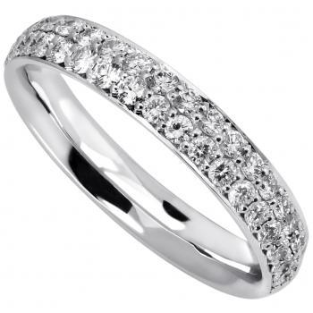 wedding ring slightly rounded outside and inside and pavé set with brilliant cut diamonds fiished with a thin engraving or border