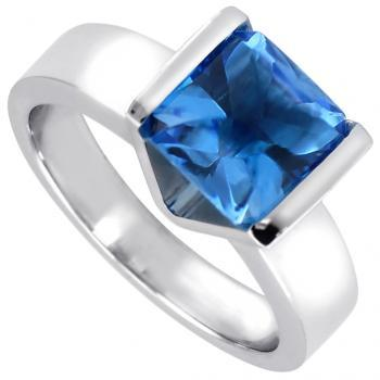 solitaire ring with a cabochon cut topaz