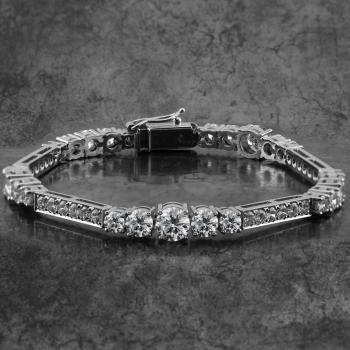 bracelet set with larger descending brilliant cut diamonds in claw setting and flankes by pavé set bars