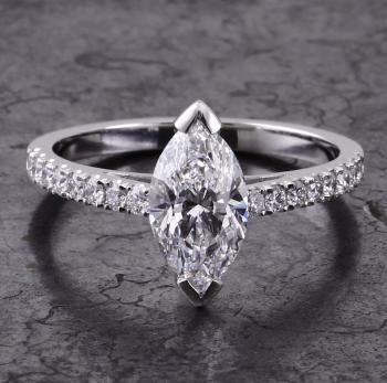 solitaire ring with a marquise cut diamond and brilliant cut on the side