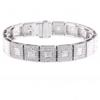 entourage bracelet with American set princess cut diamonds surrounded by castle set brilliant cut diamonds