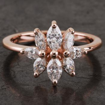 handmade engagement ring with natural marquis cut diamonds set with round prongs or claws