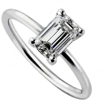 solitairering with an emerald cut diamond set in four prongs on a round band