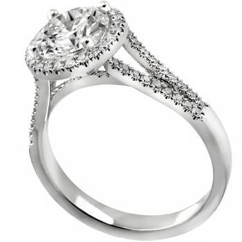 halo ring with a central diamond brilliant cut diamond surrounded by smaller diamonds all mounted on a split band