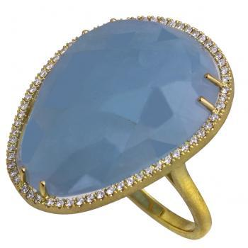 entourage ring with a central flatter briolette-cut Aquamarine surrounded with accent stones in castle-pavé setting on a satin band with palmettes