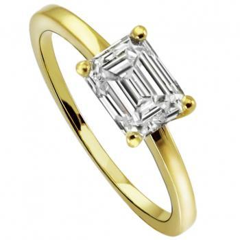 solitaire ring with an emerald cut diamond low set in four curved prongs without middlering on a tightly narrowed slightly rounded finished and slightly sloping band