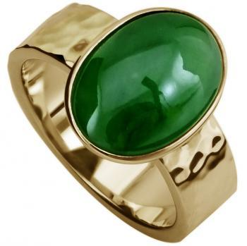 solitaire ring with aoval cabochon cut jade bezel set on an simple hammered  band