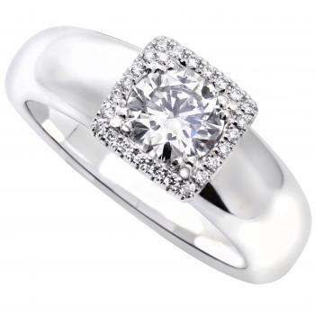 halo ring castle set with smaller round brilliant cut diamonds set around the central diamond