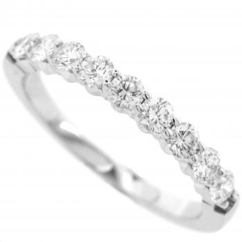 wedding ring with brilliant cut diamonds set with two prongs between each two diamonds
