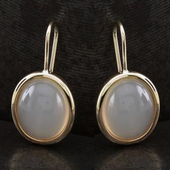 solitaire earrings with oval cabochon cut moonstones mounted in an oval rounded setting on a hook system