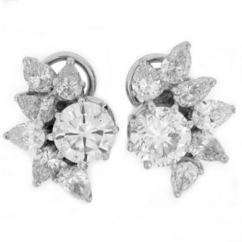 Earrings with central brilliant cut diamonds around which pear cut diamonds