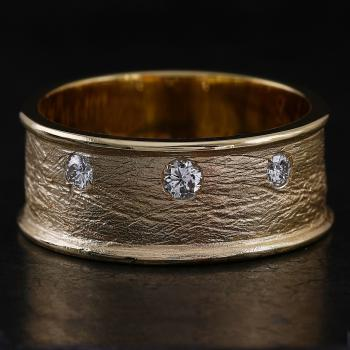 wide organic ring with thinner candle-edged edge set with three brilliant-cut diamonds