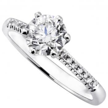 solitaire ring with a brilliant cut diamond set in 6 prongs tiffany setting with castle set smaller diamonds on the side