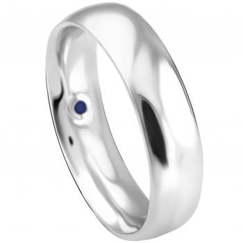 wedding ring slightly rounded also on the inside set with a small sapphire
