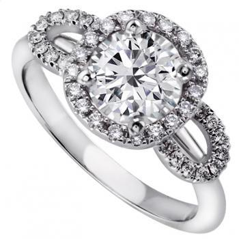 entourage ring with a central brilliant cut diamond with an entourage of castle set diamonds flanked by two arcs