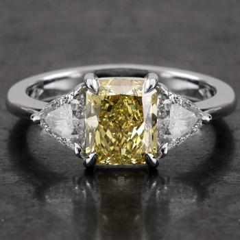 ring with a natural fancy yellow central radiant or cut-cornered rectangular modified brilliant & 2 trilliant shaped diamonds