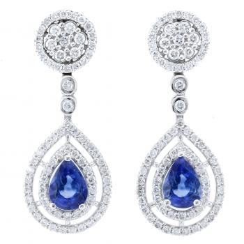 entourage earrings with pear shaped sapphires surrounded by brilliant cut diamonds
