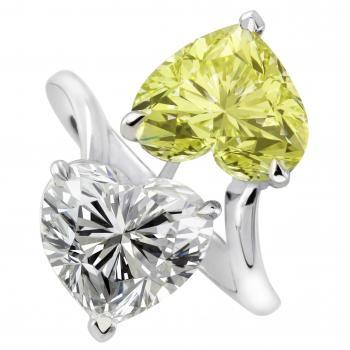 toi-et-moi ring with one white and one fancy yellow heart shaped diamond