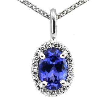 halo set pendant with a central oval cut tanzanite around which castle set diamonds