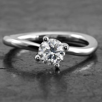 handmade solitaire ring with a brilliant cut diamond in a slightly twisted setting with four prongs