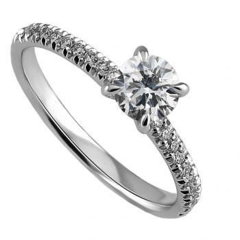 handmade solitaire ring with a brilliant cut diamond set in 4 prongs rounded setting made of round wire and the band set with smaller brilliants