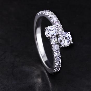 Toi et Moi ring with two brilliant cut diamonds fixed together and the band castle set with smaller diamonds