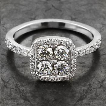 halo ring with four central brilliant cut diamond surrounded by a cushion shaped castle set halo and also diamonds on the band